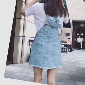 Dresses & Skirts - Denim overall mini dress with bow tie on the back